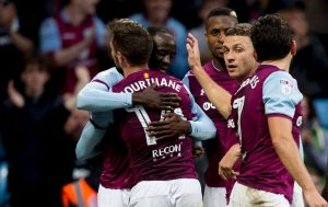 Adomah and Hourihane celebrate their goals against Forest