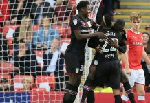 Davis and Kodjia celebrate with Adomah